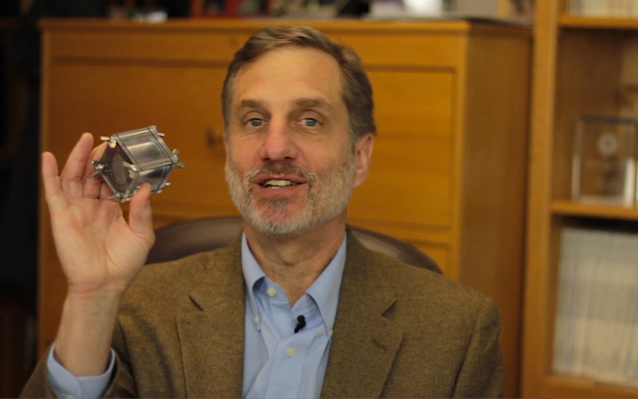 Bruce E. Logan holds up a microbial fuel cell.
