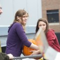 "10/31/13 Boston, MA – Julie Williams, center, and Jessica Allan, right, moves a large pumpkin filled with paint together to a chute on the roof of Boston University Metcalf Science Center for physics professor Karl Ludwig, left, to push off. ""I'm a rookie,"" said Ludwig. Photo by XiaoZhi Lim"